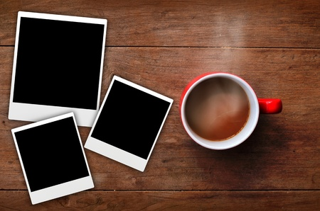 Red cup coffee with frame picture on wood background photo