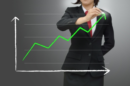 Business women writing green arrow
