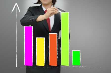 Business woman drawing growing graph Stock Photo - 15589802