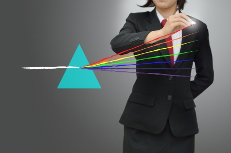 dispersion: Business woman drawing light of prism Stock Photo