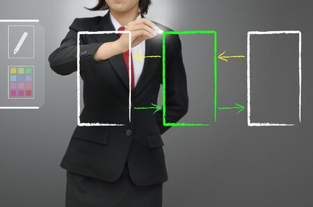 flow diagram: Business woman drawing data flow concept diagram Stock Photo