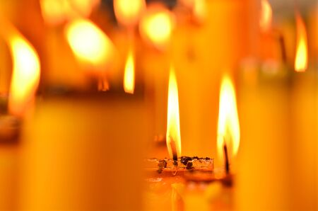 Golden light of candle flame in Chinese Vegetarian Festival photo