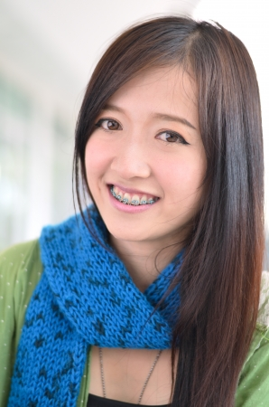 Student asian girl is smile and showing teeth photo