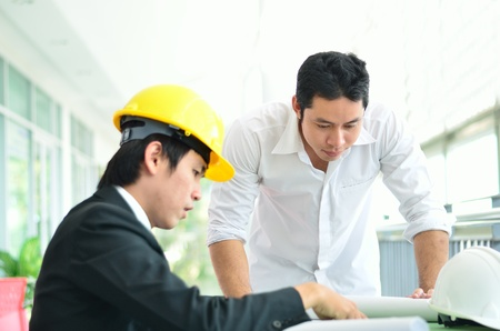 Two engineers are planning serious photo