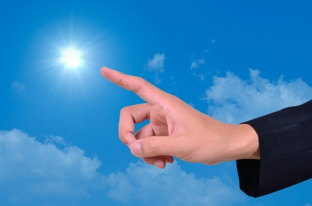 Businessman hand finger sky and sun  photo