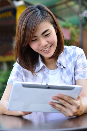 Beautiful young student have good news on the tablet screen Stockfoto
