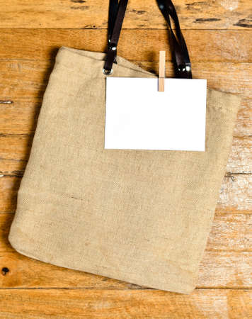 antiqued: shopping bag on old wooden background for natural recycle concept