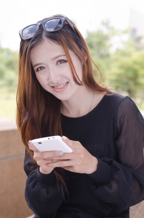 office use: Close up beautiful young woman using a mobile phone
