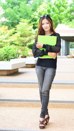 Asian women student looking profile in university and smiling face photo