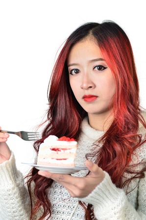 Close up beautiful asian women with red long hair eating cake photo