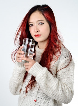 Asian women with red color long hair drinking water photo