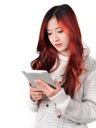 asian women with red color long hair using tablet photo