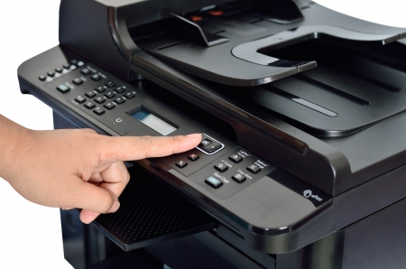 Close up multifunction printer with finger on ok button Stockfoto