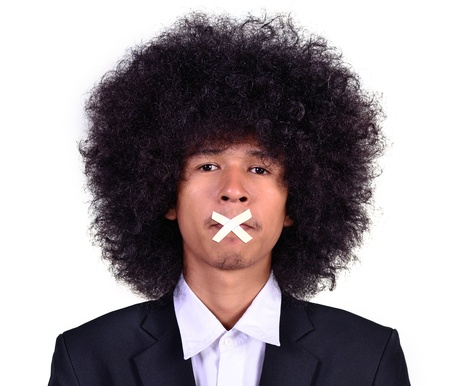 Long-haired business man closing mouth as top secret concept Stock Photo - 21145343