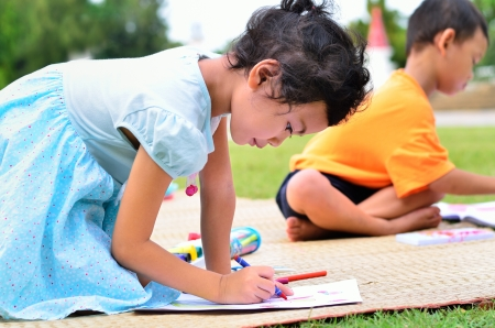 thai painting: Going back to school   Children drawing and painting over green grass background