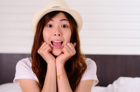 Close up Asian woman teenager have a surprised face emotion