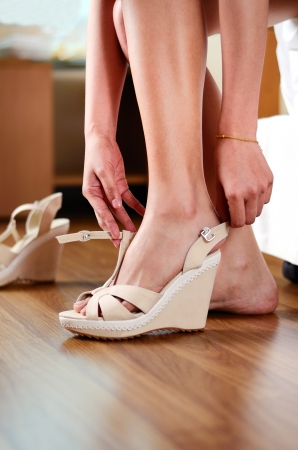 woman teenage wear the shoes before start of shopping Stock Photo - 22954868