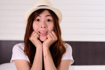 Close up Asian woman teenager have a surprised face emotion photo