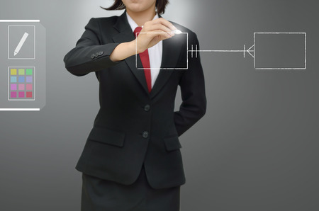 entity: business woman drawing entity relation diagram  ERD  and Database design