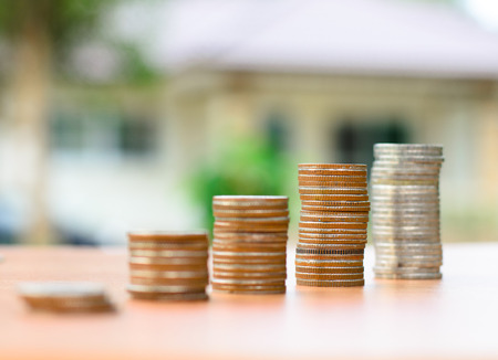 money coins stack like growing graph with home, Saving for buy home concept