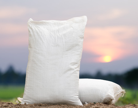 Agriculture, Fertilizer bag over sunrise background