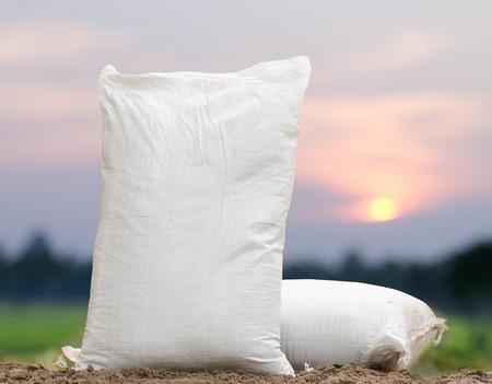Agriculture, Fertilizer bag over sunrise background