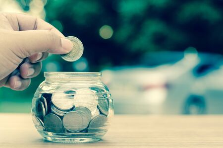 money concept: saving money for buy car concept,bank,piggy bank,Money,Coins,Tree, Sprout growing on glass piggy bank with sunset light