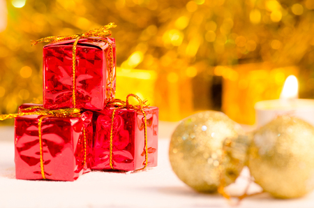 christmas scene and new year background for art design with red gift box, snow gold bokeh background