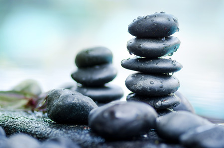 Close up heap of spa stones with water drop still life style