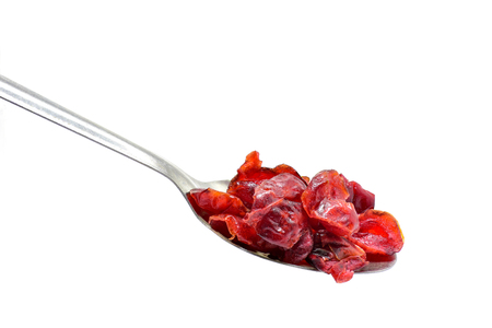 cranberry dried fruit on spoon isolate in white background