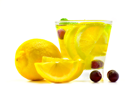 detox water drink in glass with lemon grape and soda water isolate