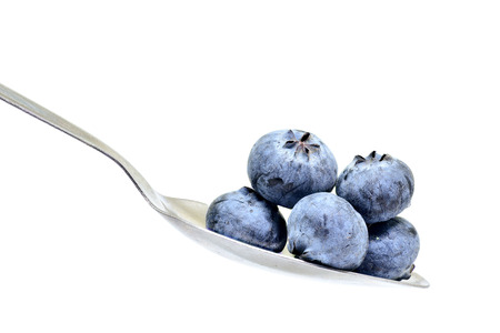 blue berry on spoon isolated on white background for design Zdjęcie Seryjne - 111277464