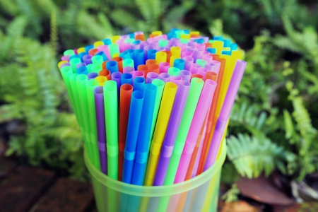 natur: Colored plastic drinking straws on a natur background