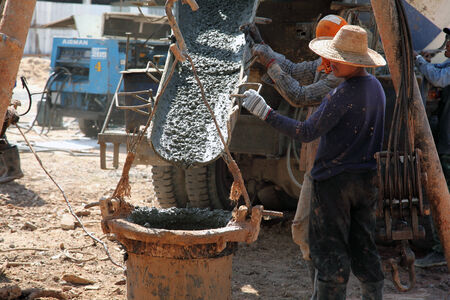 construction worker controlling pile form filling with continuous concrete casting  photo