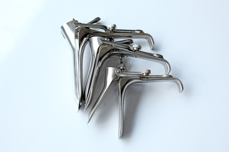speculum: Gynecologic speculum on a white background  Stock Photo