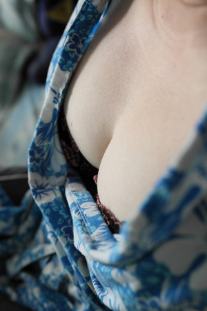 Close up of a womans breasts cleavage photo
