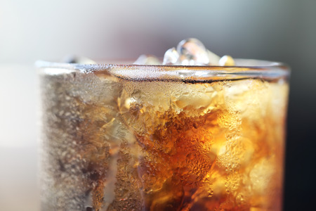 Cola with Ices in glass photo