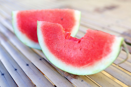 Sweet watermelon slices on wooden table photo