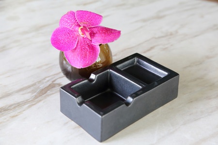 quiting smoking: Empty black ash tray on a stone background  Stock Photo