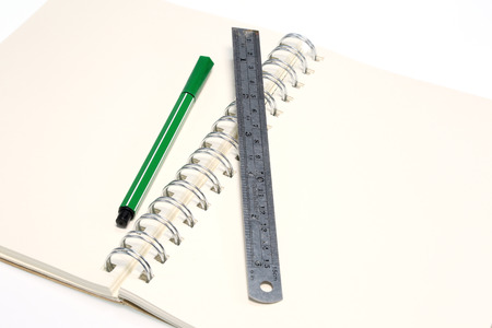 Pen and ruler  on blank note book  photo