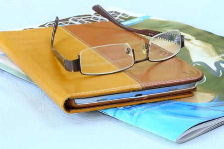Eyeglasses on ipad and book photo