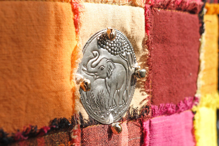 Silver elephant  handmade on fabric background in Thailand photo