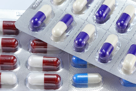 Pills of capsules in blister pack closeup  photo
