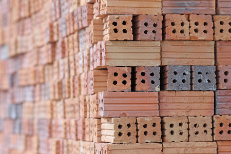 A stack of red clay bricks  photo