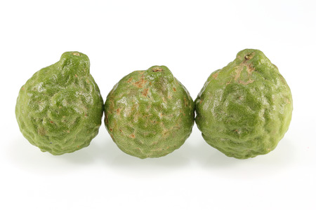 Bergamot fruits in nature on white background  photo