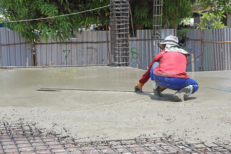 Plasterer at outdoor concrete cement floor photo