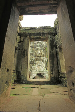 angor: One of the giant stone faces at Bayon Temple at Angkor Wat, Cambodia