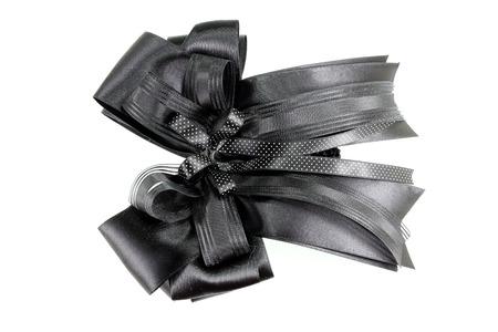 bow hair: Arco de pelo negro sobre fondo blanco Foto de archivo