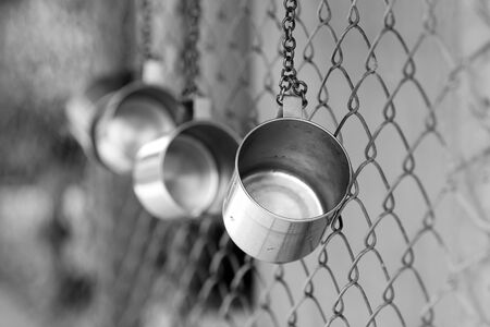 tin cup in school. black and white style photo