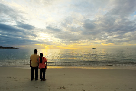 Man and woman standing by the sea